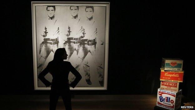 Triple Elvis by Andy Warhol