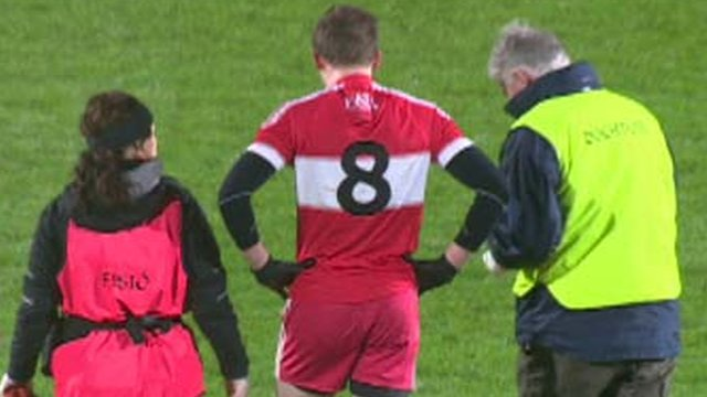 Brendan Rogers leaves the pitch at the start of the McKenna Cup Final