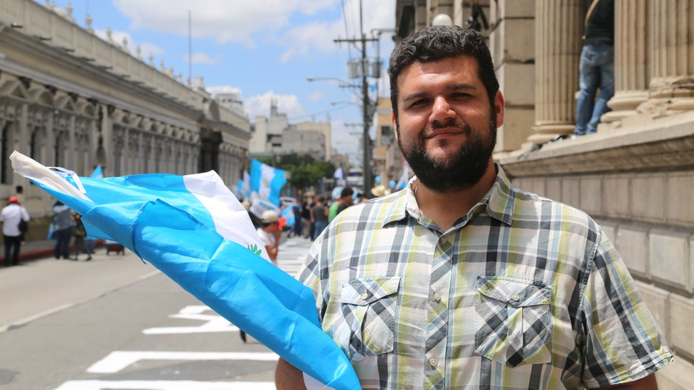 Protester Gabriel Wer holds a flag in Guatemala City - September 2015