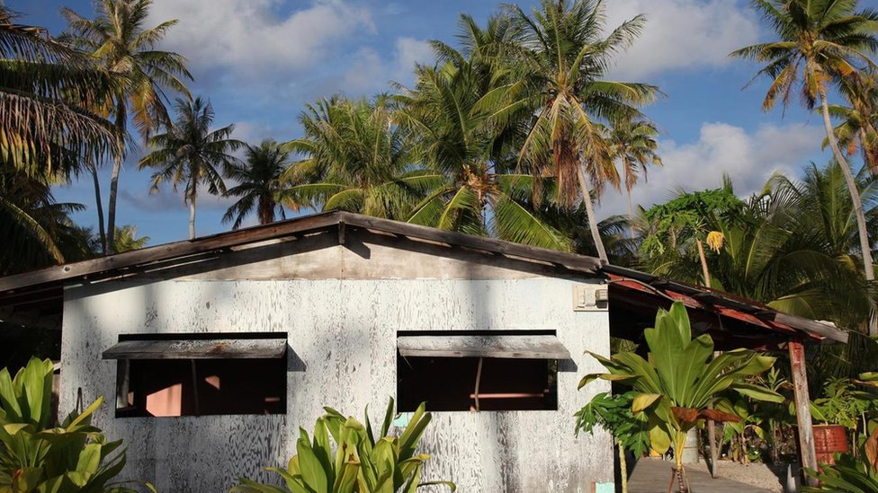 Most of the homes on Tepoto are wooden bungalows with cut-out windows
