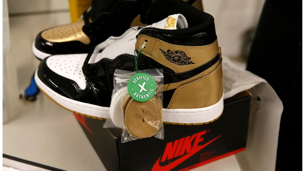 A pair of Air Jordan 1 Retro shoes are seen before being packed to ship out of Stock X.