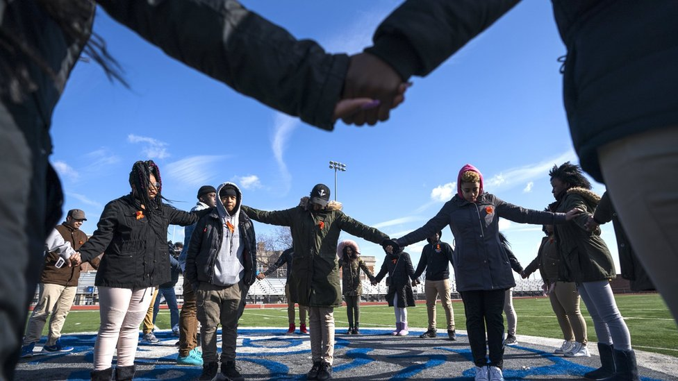 Eastern High School students walk out of class and assemble on their football field for the National School Walkout, in Washington, DC, 14 March 2018.