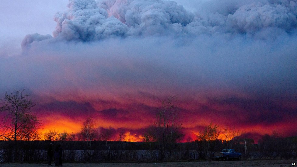A huge cloud forms over the wildfires in Fort McMurray, Canada.