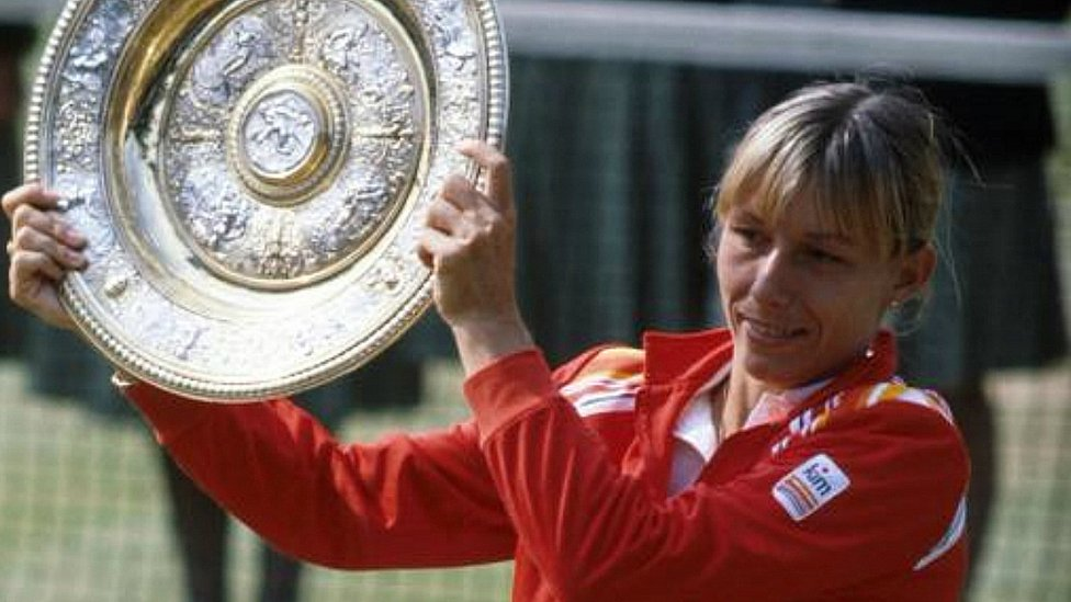 Martina Navratilova with her trophy for beating Chris Evert Lloyd to win the women's singles of the Wimbledon Lawn Tennis Championships 1982