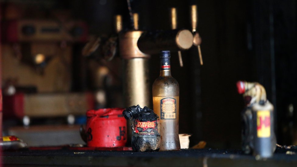 Bottles destroyed by fire in a bar in Rouen (6 August 2016)