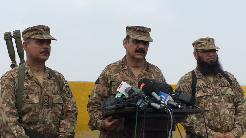 Members of the Pakistan military speak at a press conference event near the LOC area.