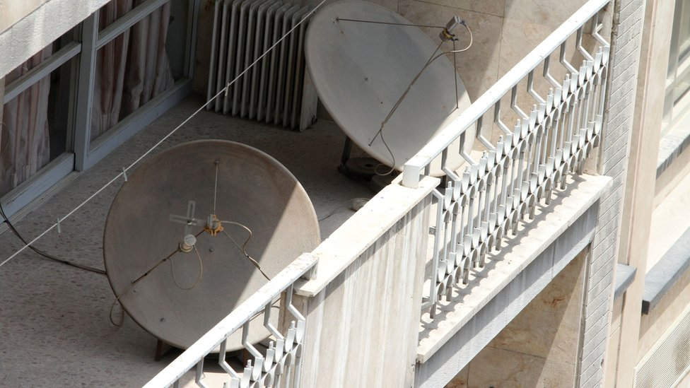 Satellite dishes on a balcony in a northern district of the Iranian capital Tehran (24 July 2016)