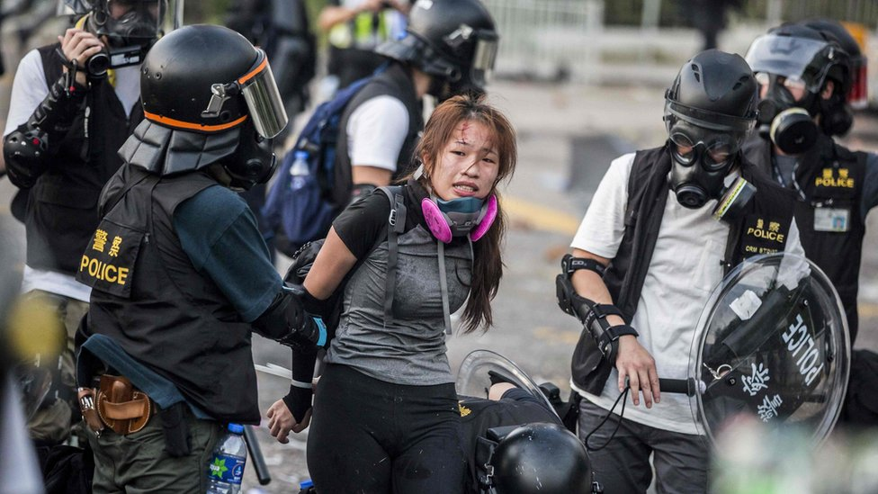Police detain demonstrators in the Sha Tin district of Hong Kong on October 1, 2019