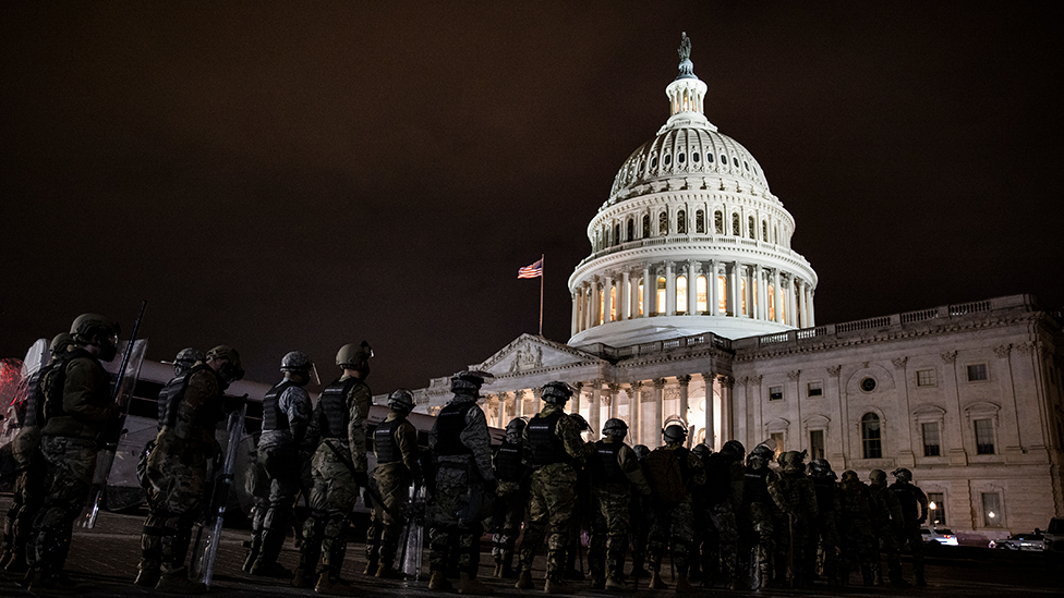Members of the National Guard and the Washington D.C. police stand guard to keep demonstrators away from the U.S. Capitol - 6 January 2021