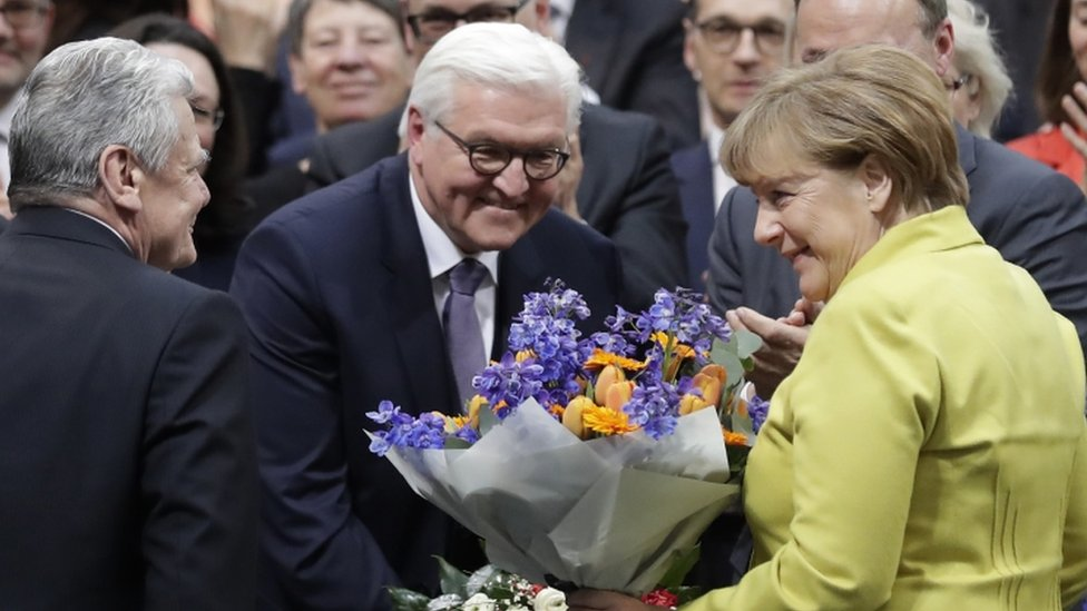 Newly elected German President Frank-Walter Steinmeier, centre, is congratulated by German President Joachim Gauck, left, and German Chancellor Angela Merkel, right.
