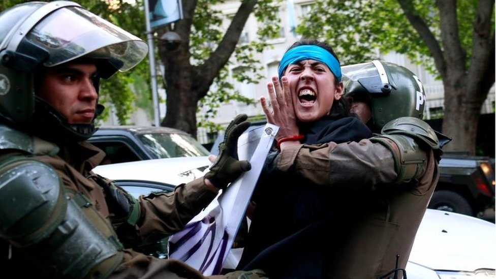 A Mapuche Indian activist is detained during a protest in support of Rafael Nahuel, a Mapuche Indian activist and Argentinian who was shot dead during clashes near Bariloche, southern Argentina according to local media, in Santiago, Chile, November 27, 2017