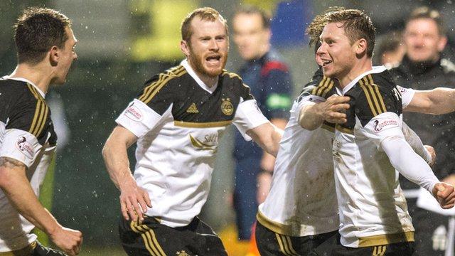 Simon Church celebrates after making it 2-1 to Aberdeen