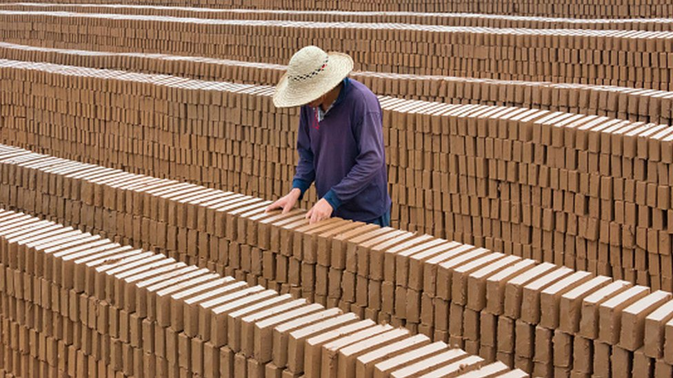 A man at a brick factory in China