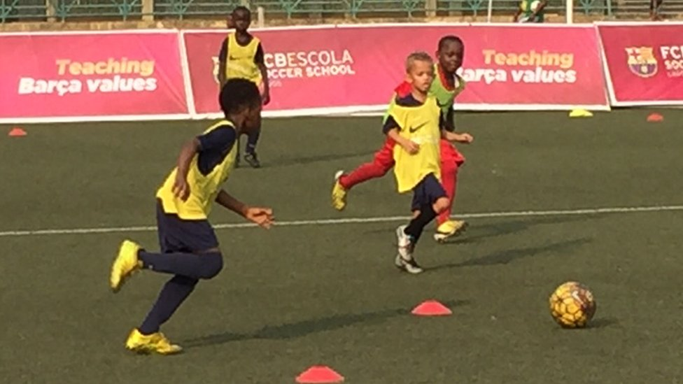 Group of children playing football at the Barcelona Lagos Academy inside the Teslim Balogun Stadium Complex in Surulere.