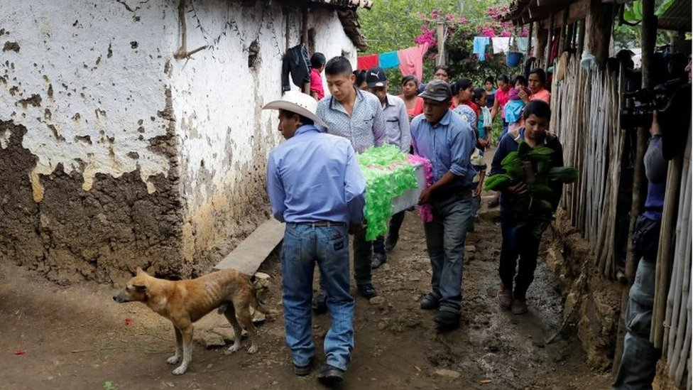Relatives carry the coffin with the body of 2-1/2-year-old Guatemalan migrant Wilmer Josue Ramirez, who was detained last month at the U.S.-Mexico border but released from U.S. custody with his mother during treatment for an illness, toward the cemetery during his funeral in the village of Olopa, Guatemala May 26, 2019.