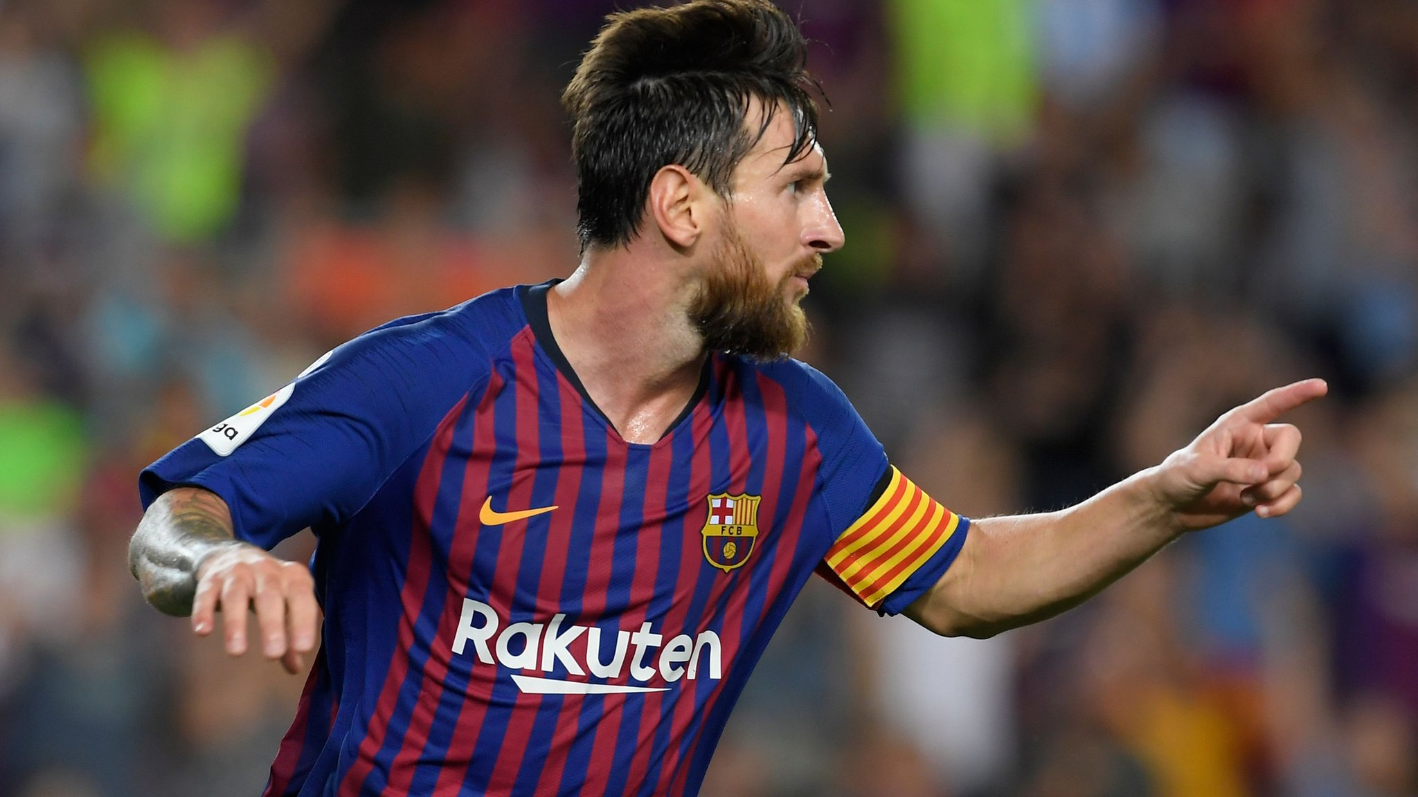 Messi scores twice as Barca open title defence with win