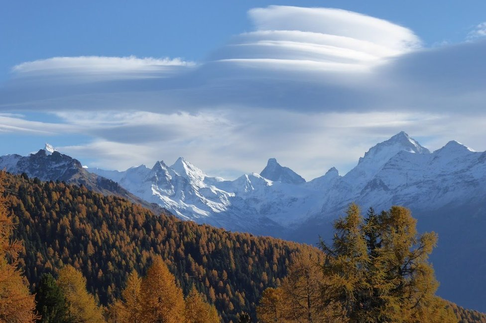 Clouds above mountains and forests