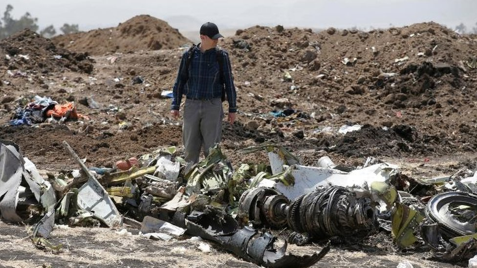 American civil aviation and Boeing investigators search through the debris at the scene of the Ethiopian Airlines Flight ET 302 plane crash