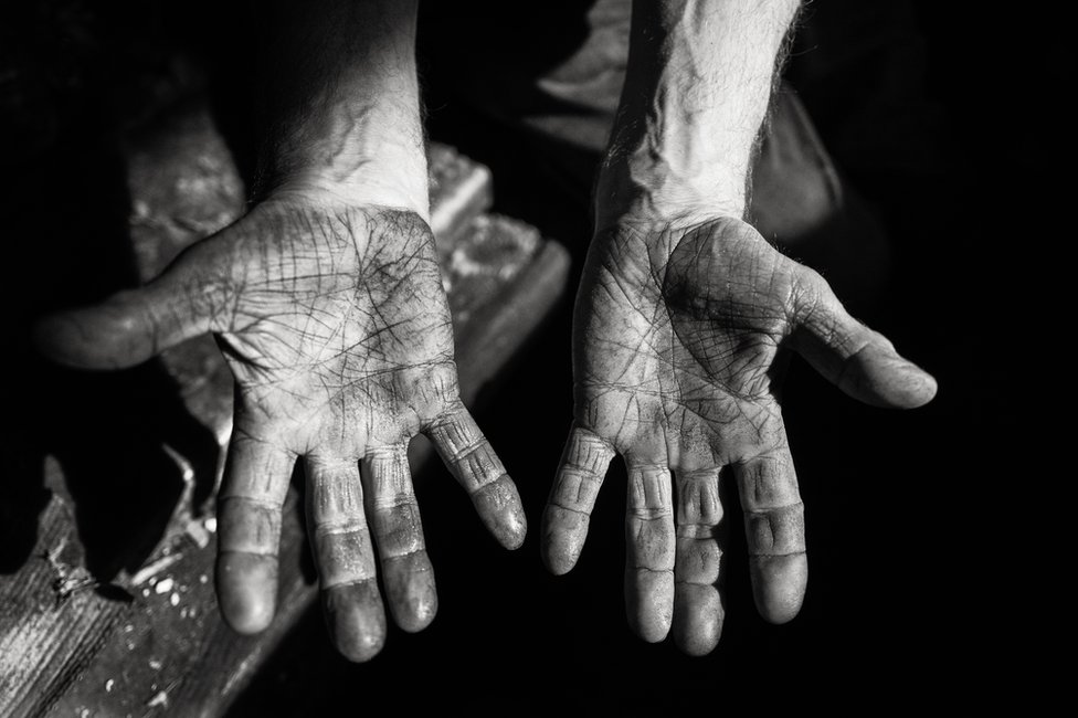 A man holding out his hands showing his palms