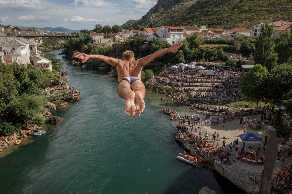 A competitor dives from Stari Most, also known as Old Bridge, on 26 July 2020, in Mostar, Bosnia and Herzegovina