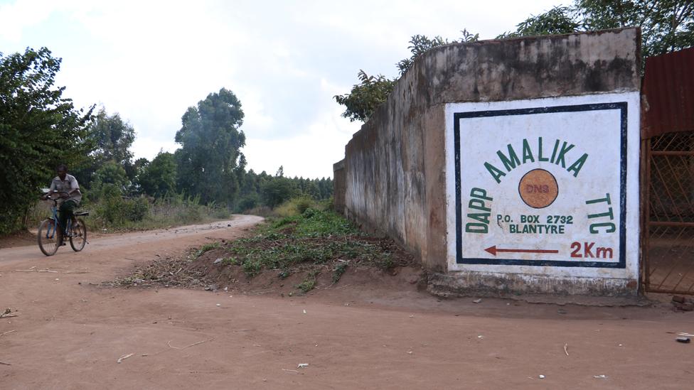 Dapp Amalika signpost on roadside in Malawi