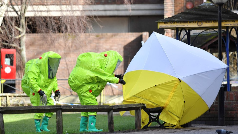 Experts at tent over the bench where where Sergei Skripal and his daughter Yulia were found on March 4, 2018