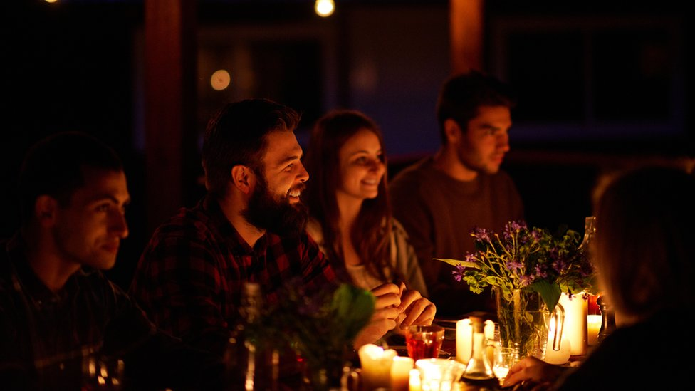 Cena con velas