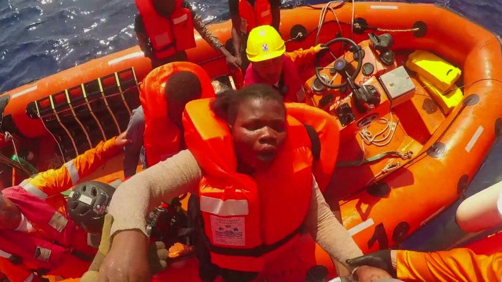 A pregnant migrant is brought on board a Save the Children vessel