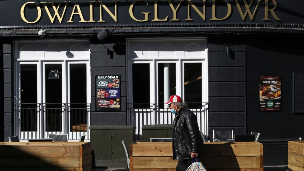 Man walks past pub in Cardiff