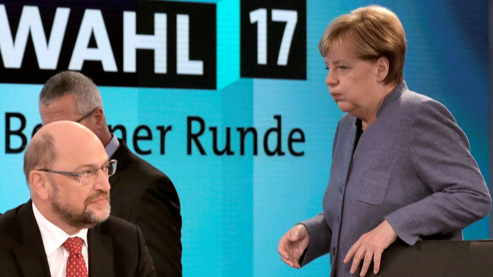 Angela Merkel looks exasperated with Martin Schulz on a TV set before a post-election debate