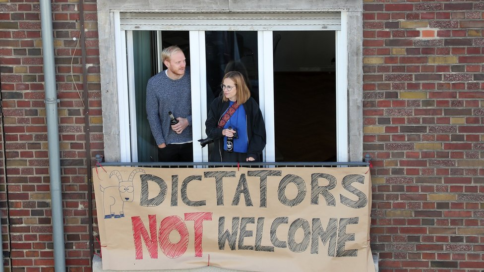 """A placard on a balcony reads """"Dictators not welcome"""", near the DITIB Central Mosque in Cologne, Germany on 29 September 2018."""