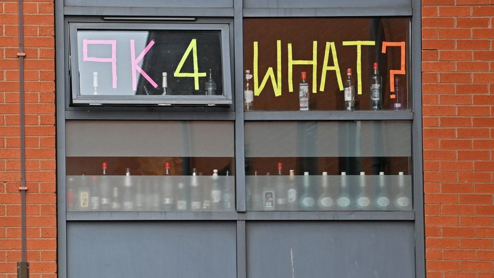 Students stick messages on the windows of their accommodation while self-isolating