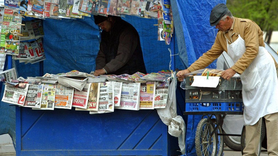 Newspaper seller in Bucharest