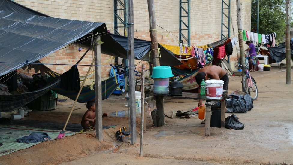 Members of the Warao indigenous community have built shelters of tarpaulin