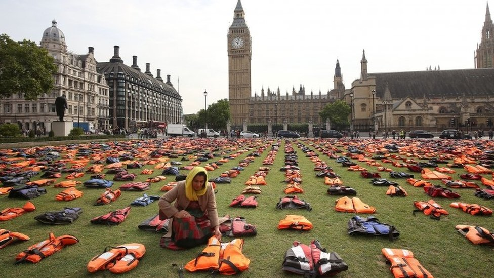 Migrants' life jackets on display in Parliament Square