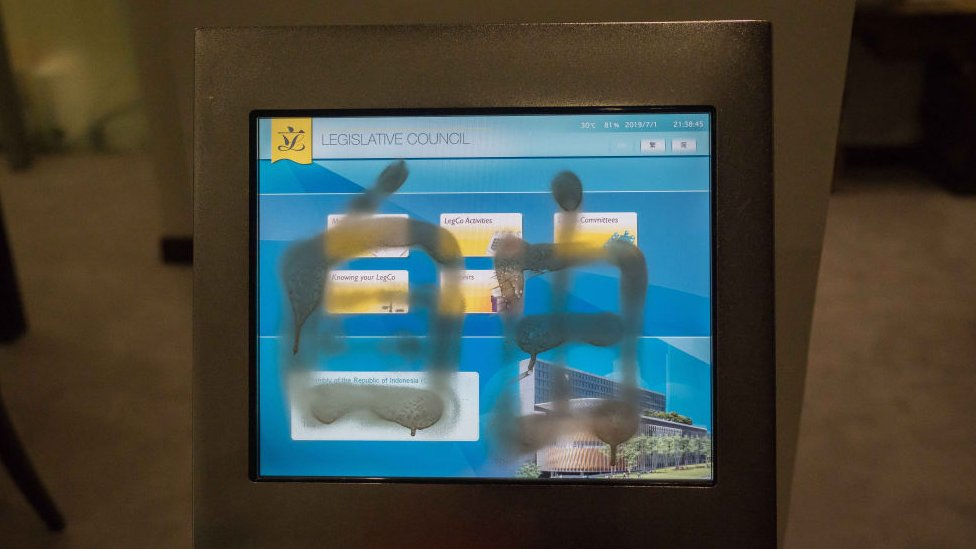A graffiti is seen sprayed on a machine inside the Legislative Council Complex