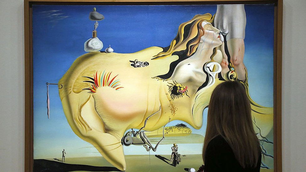 A visitor looks at a painting, The Great Masturbator, by Spanish surrealist artist Salvador Dali during an exhibition of his work at the Centre Pompidou in Paris on 19 November 2012