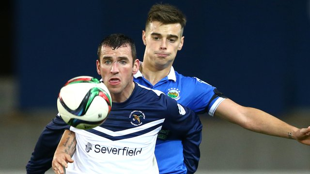 Ryan Campbell and Matthew Clarke in action at Windsor Park