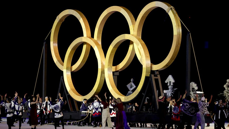 Performers dance in front of a giant golden Olympic Rings during the Opening Ceremony of the Tokyo 2020 Olympic Games at Olympic Stadium on July 23, 2021 in Tokyo, Japan.