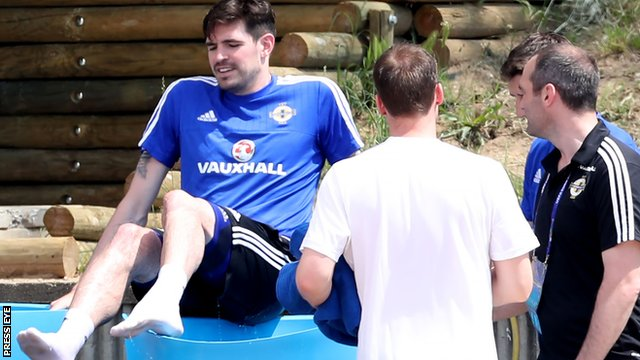 Northern Ireland striker Kyle Lafferty climbs into an ice bath after suffering an injury scare during training ahead of Sunday's Euro 2016 opener against Poland