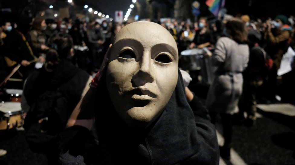 A demonstrator wearing a mask takes part in protest against imposing further restrictions on abortion law, near the house of Law and Justice leader Jaroslaw Kaczynski in Warsaw, Poland, 23 October, 2020.