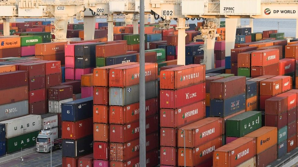 Containers are stacked at the port of Jebel Ali, operated by the Dubai-based giant ports operator DP World, in the southern outskirts of the Gulf emirate of Dubai, on June 18, 2020