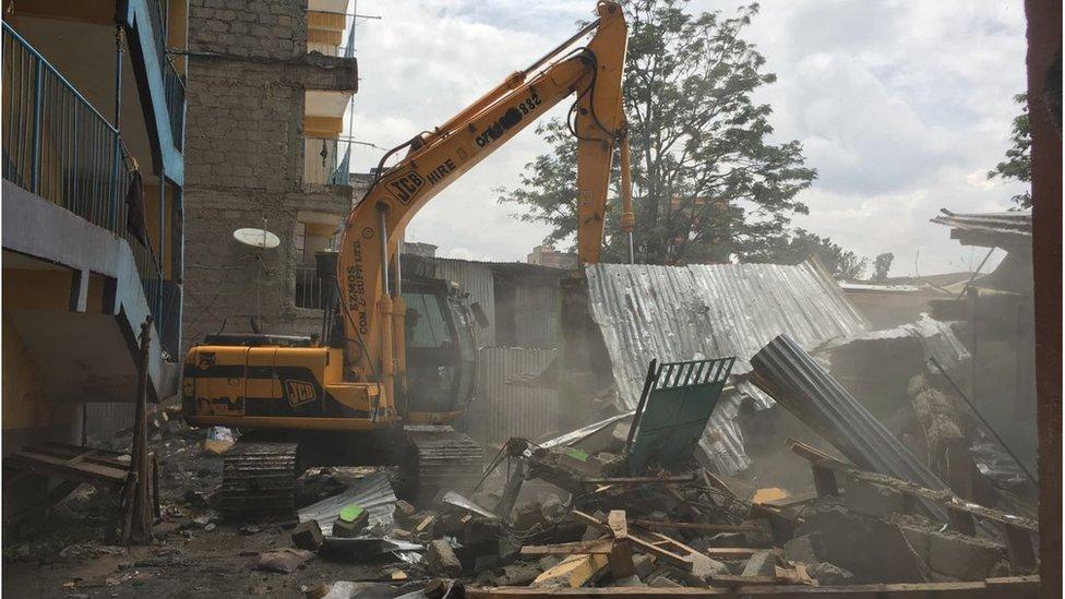 Bulldozer demolishing buildings in Hurama, Nairobi, 6 May 2016