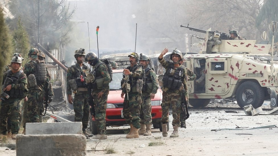 Afghan security officers at the scene of the attack in Jalalabad