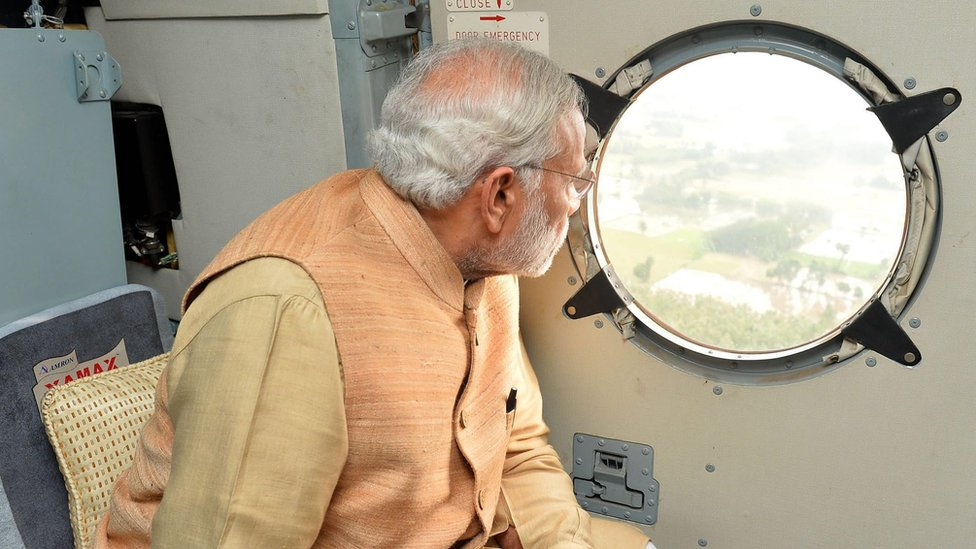 Indian Prime Minister Narendra Modi conducting aerial survey of a rain hit area in Chennai