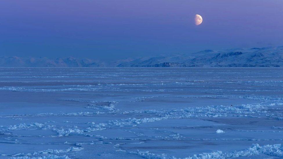 Moon over ice