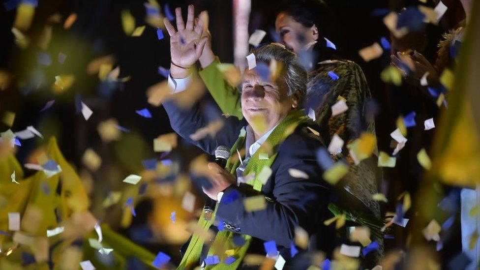 The Ecuadorean presidential candidate of the ruling Alianza PAIS party, Lenin Moreno, waves to his supporters as they wait for the final results of the runoff election, in Quito on April 2, 2017.