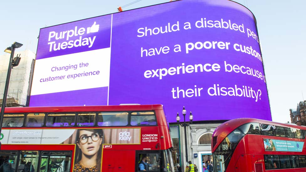 Electronic billboard explains Purple Tuesday at Piccadilly Circus in London