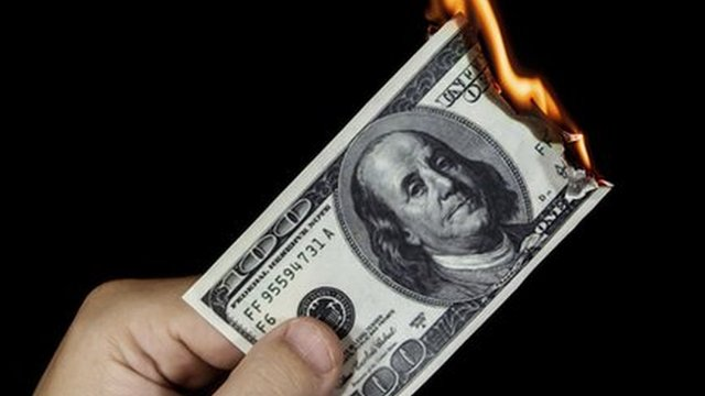 a dollar bill on fire
