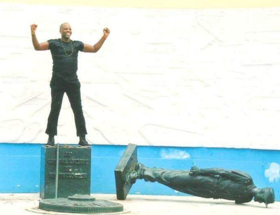 The first time Mr Essama toppled Gen Leclerc's statue in 2003
